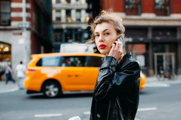 Attractive woman using mobile phone in the street