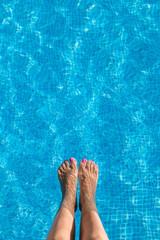 Woman Feet in the Pool