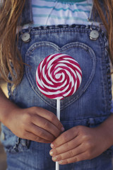 Child holding lollipop