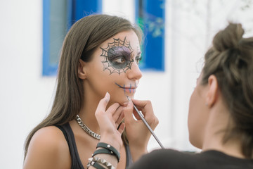 Close up of a Young Woman with Skull Mask for Halloween