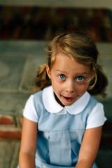 little girl in uniform on her first day of kindergarten