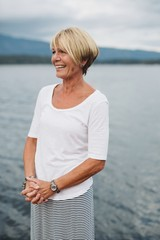 Portrait of mature woman near water smiling