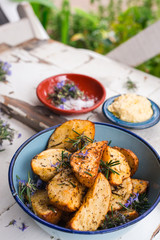delicious roasted potatoes in a rustic enamel blue bowl
