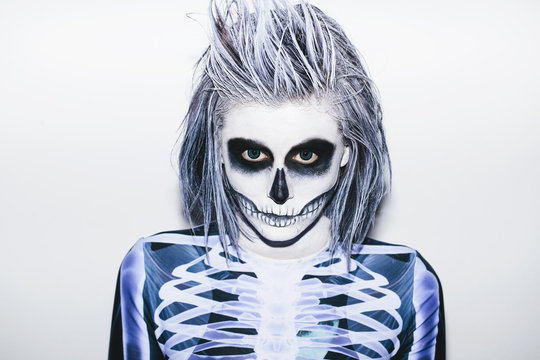Portrait of a young woman with halloween make up and skeleton costume