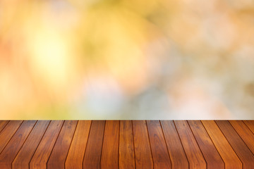 Wood table top on bokeh orange background - can be used for montage or display your products