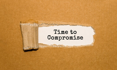 The text Time to compromise appearing behind torn brown paper