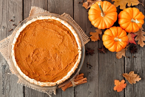 Autumn Pumpkin Pie Above View Table Scene On A Rustic Wood Background