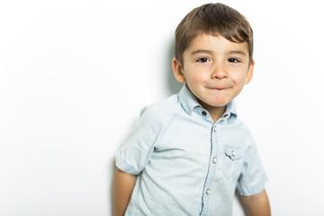 Boy having fun on studio grey background