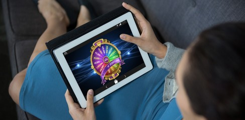 Composite image of wheel of fortune on mobile screen