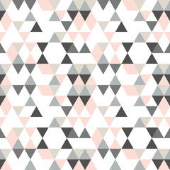 Geometric abstract pattern with triangles in muted  retro colors.