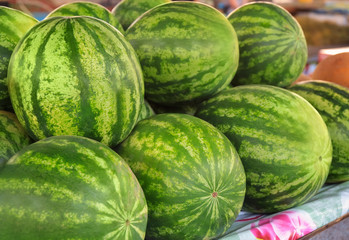 Fresh watermelons on counter at market
