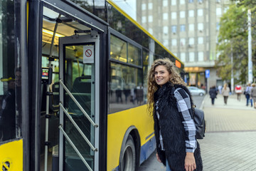 Young woman enters bus