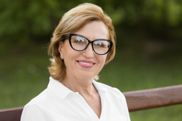 Mature lady in glasses outdoors