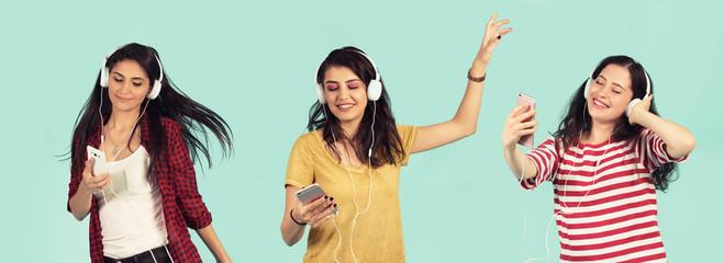 happy girls enjoy listening to music with earphone