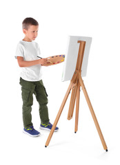 Talented boy painting on canvas against white background
