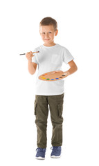 Cute boy with brush and palette against white background