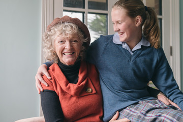 grandmother with granddaughter, sharing a laugh