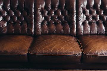 Old run down leather sofa close up