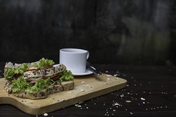 Coffee sandwich on wooden floor
