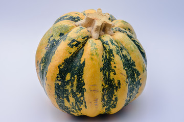 Yellow and green pumpkin on white background