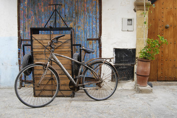 Rusty bicycle on a street of medina