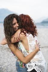 Affectionate best friends hugging