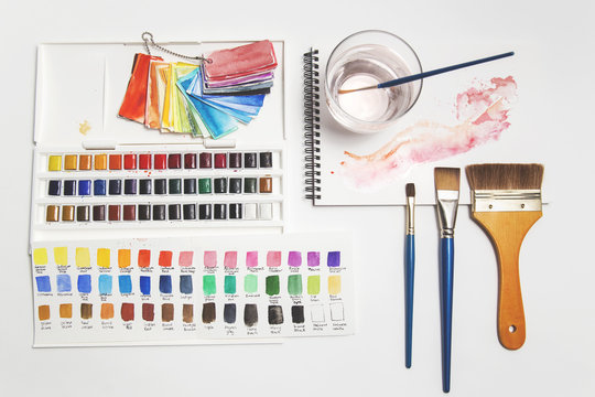 Watercolour paints, brushes, swatches and paper...