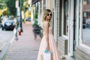 Beautiful woman in a dress out shopping