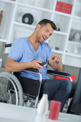 happy disabled man watching tv
