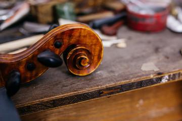 Violin scroll on a workbench