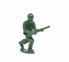 miniature toy soldier on white background; close-up