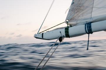 Boom of sailboat sailing at sea