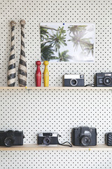 Pegboard / Perforated board with shelves in a studio office