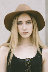 portrait of real young woman with hat