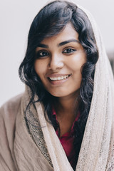 happy portrait of indian young woman wearing headscarf