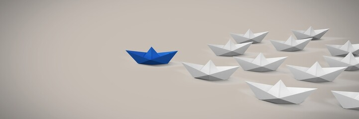 Group of Paper boats on soft pink background
