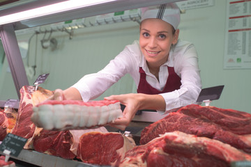 female butchers works at a supermarket