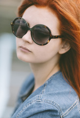 portrait of  young woman  with round retro sunglasses