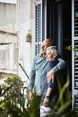 Senior Couple Embracing On Balcony