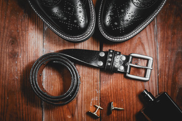 Male accessories. Shoes with perfume and belt