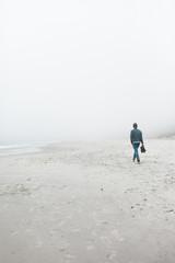 Man on foggy beach