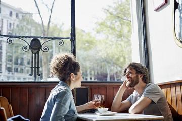 Cheerful Couple Having Wine In Restaurant