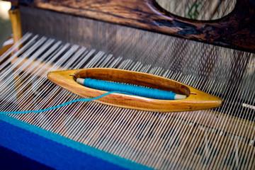 Weaving shuttle on loom