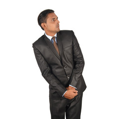 Portrait of a young businessman in black suit screaming with fear and a strange face expression over white background