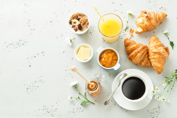 Continental breakfast on stone table from above - flat lay