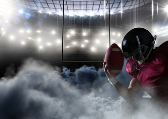 american football player in stadium with smoke