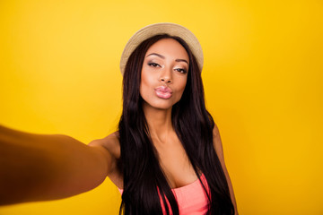 Relax, rest, chill mode! Gorgeous carefree dreamy traveller in trendy beige head wear sends kiss, so hot, fit and slim, taking selfie shot, makes memories at holiday and fir her blog