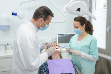 patient with two dentists