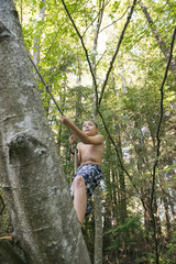 Boy Prepares To Use Rope Swing Into River