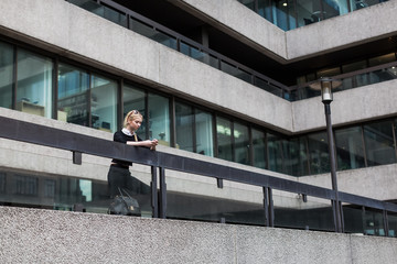 Business woman using a smartphone outdoor